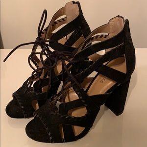 Black tie up heels with zipper. Never worn